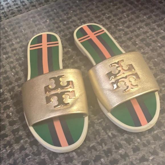 d79287463a7b Tory Burch Womens Logo Jelly Slide Sandals. M 5c8c11aeaaa5b87e31d7a0a0